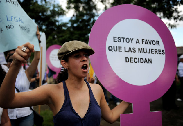 "Nicaraguan activists take part in a protest in favour of abortion during the Day for the Decriminalization of Abortion in Latin America and the Caribbean,  in Managua, on September 28, 2011. The sign reads ""I am in favour of women to decide"".    AFP PHOTO/ ELMER MARTINEZ"